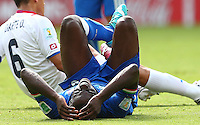 Mario Balotelli of Italy feels the pain from an injury