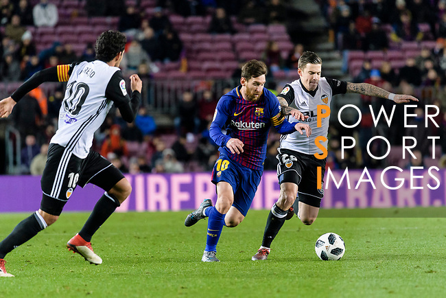 Lionel Messi of FC Barcelona (L) in action against Santiago Mina Lorenzo of Valencia CF (R) during the Copa Del Rey 2017-18 match between FC Barcelona and Valencia CF at Camp Nou Stadium on 01 February 2018 in Barcelona, Spain. Photo by Vicens Gimenez / Power Sport Images