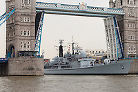 HMS Edinburgh arrives in London under Tower Bridge on 7 May 2013 for the start of her farewell tour of Great Britain. HMS Edinburgh is a Type 42 (Batch 3) destroyer of the Royal Navy was decommissioned on 6 June 2013.
