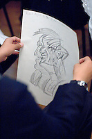 State school students show off their own work done during their visit to the National Portrait Gallery, London.