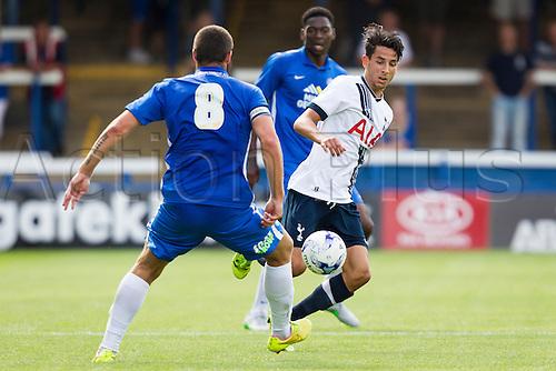 a18.07.2015.  Peterborough, Engand. Pre Season Friendly Peterborough United versus Tottenham Hotspur. Ismail Azzaoui (Tottenham Hotspur) looks to beat Michael Bostwick (Peterborough United).
