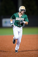 Brett Netzer (9) of the Charlotte 49ers rounds the bases after hitting a walk-off home run with two outs in the bottom of the 9th inning against the Wake Forest Demon Deacons at Hayes Stadium on March 16, 2016 in Charlotte, North Carolina.  The 49ers defeated the Demon Deacons 7-6.  (Brian Westerholt/Four Seam Images)