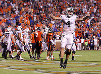 Brigham Young quarterback Taysom Hill (4) celebrates after scoring a touchdown during the second half of the game against Virginia in Charlottesville, Va. Virginia defeated Brigham Young 19-16. Photo/Andrew Shurtleff