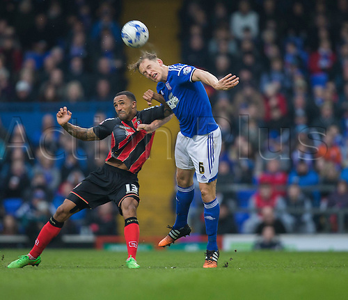 03.04.2015.  Ipswich, England. Skybet Championship. Ipswich Town versus AFC Bournemouth. Bournemouth's Callum Wilson (left) and Ipswich Town's Christophe Berra battle for the ball.