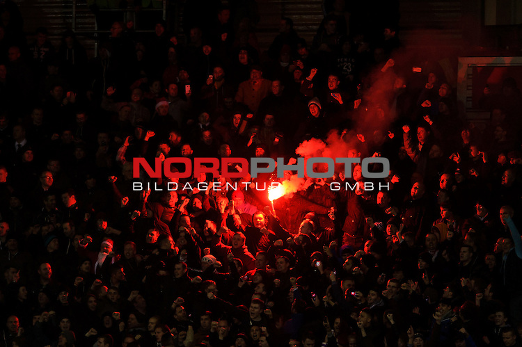 Man Utd fans light a  red flare in the away stand during the second half of the match -  - 18/12/2013 - SPORT - FOOTBALL - Britannia Stadium, Stoke - Stoke City v Manchester United - Capital One Football League Cup Quarter-Final.<br /> Foto nph / Meredith<br /> <br /> ***** OUT OF UK *****