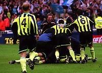 Manchester City Assistant Manager, Willie Donachie. leaps onto the Manchester City players to celebrate winning the Division Two Play-Off Final during Manchester City vs Gillingham, Nationwide League Division Two Football at Wembley Stadium on 30th May 1999