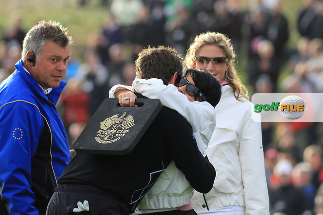 Lee Westwood give wife a big hug after beating the paring of Mickelson and Johnson 3and2 on the 16th green during the third session of the Friday Fourballs on saturday at the,.2010 Ryder Cup at the Celtic Manor twenty ten course, Newport Wales, 1/10/2010.Picture Fran Caffrey/www.golffile.ie.