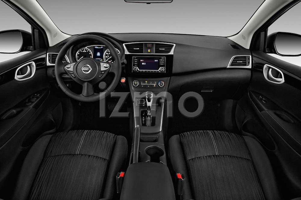Stock photo of straight dashboard view of 2017 Nissan Sentra SV 4 Door Sedan Dashboard