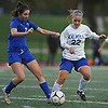 Annie Coogan #22 of Calhoun, right, gets pressured by Carlin Steincke #7 of Port Washington during the Nassau County varsity girls soccer Class AA semifinals at Cold Spring Harbor High School on Monday, Oct. 30, 2017. Coogan scored Calhoun's second goal in the team's 3-0 win.