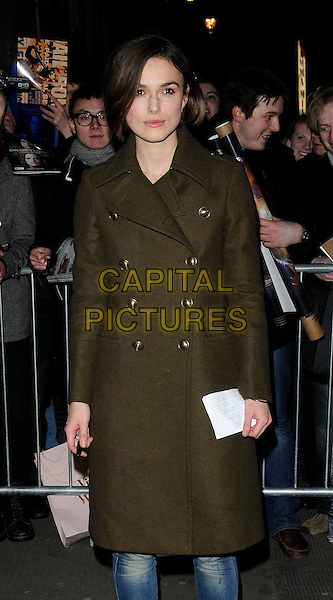 "KEIRA KNIGHTLEY .Departing after an evening performance of ""The Children's Hour"", the Comedy Theatre, London, England..January 27th, 2011.half length khaki green military coat buttons jeans .CAP/CAN.©Can Nguyen/Capital Pictures."