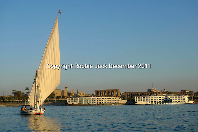 A felucca on the River Nile at Luxor.The town of Luxor occupies the eastern part of a great city of antiquity which the ancient Egytians called Waset and the Greeks named Thebes.