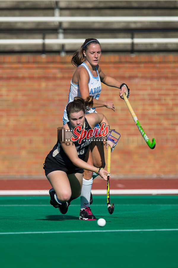 Shannon Eby (19) of the Wake Forest Demon Deacons is tripped up during second half action against the North Carolina Tar Heels at Kentner Stadium on October 23, 2015 in Winston-Salem, North Carolina.  The Demon Deacons defeated the Tar Heels 3-2.  (Brian Westerholt/Sports On Film)
