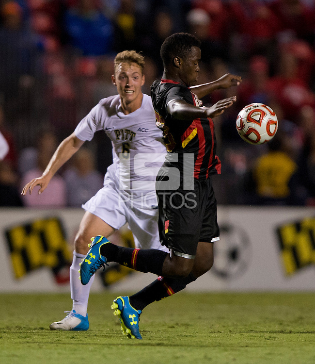 Schillo Tshuma (23) of Maryland controls the ball in front of John Cordier (6) of Pittsburgh during the game at Ludwig Field on the campus of the University of Maryland in College Park, MD.  Maryland defeated Pittsburgh, 2-0.