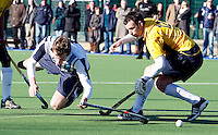 Alex Collins (L) of Hampstead takes a tumble during the EHL Mens Cup Quarter-Final game between Hampstead and Westminster and Old Loughtonians at the Paddington Recreation Ground, Maida Vale on Sun Mar 7, 2010