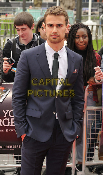 LONDON, ENGLAND - MARCH 30: Theo James attends the &quot;Divergent&quot; UK film premiere, Odeon Leicester Square cinema, Leicester Square, on Sunday March 30, 2014 in London, England, UK.<br /> CAP/CAN<br /> &copy;Can Nguyen/Capital Pictures