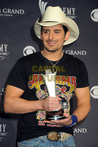 BRAD PAISLEY.46th Annual Academy of Country Music Awards - Press Room held at the MGM Grand Garden Arena, Las Vegas, NV, USA..April 3rd, 2011.award winner trophy black t-shirt half length white stetson cowboy hat stubble facial hair.CAP/ADM/BP.©Byron Purvis/AdMedia/Capital Pictures.