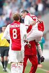 Nederland, Amsterdam, 25 maart 2012.Eredivisie .Seizoen 2011-2012.Ajax-PSV.Ismail Aissati van Ajax springt in de armen van een reservespeler nadat hij een doelpunt heeft gemaaklt