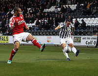 Dougie Imrie crossing past Josh Magennis in the St Mirren v Aberdeen Clydesdale Bank Scottish Premier League match played at St Mirren Park, Paisley on 9.11.12.
