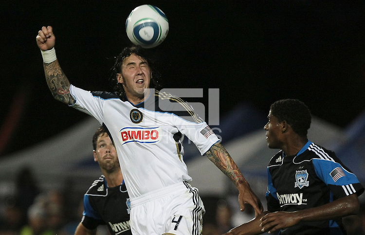 Danny Califf (4) heads the ball over Bobby Burling (left) and Khari Stephenson (7). The San Jose Earthquakes tied the Philadelphia Union 0-0 at Buck Shaw Stadium in Santa Clara, California on July 9th, 2011.