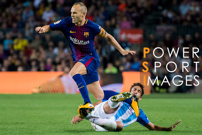 Andres Iniesta Lujan of FC Barcelona jumps to avoid Rodrigo Emanuel Cecchini of Malaga CF during the La Liga 2017-18 match between FC Barcelona and Malaga CF at Camp Nou on 21 October 2017 in Barcelona, Spain. Photo by Vicens Gimenez / Power Sport Images