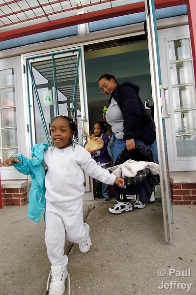 Roshanda Green picks up her son Tyshon from day care in East St. Louis, Illinois. Green has participated in child development and skills training programs of the Lessie Bates Davis Neighborhood House, and her son attends the center's day care program.