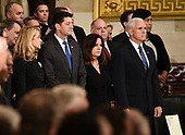 US Vice President Mike Pence (R), Second Lady of the United States Karen Pence (2R), Speaker of the United States House of Representatives Paul Ryan (R-WI) (2L), and his wife Janna Ryan (L) wait for the arrival of the casket of former US President George H.W. Bush  at the US Capitol in Washington, DC, December 3, 2018. - The body of the late former President George H.W. Bush travelled from Houston to Washington, where he will lie in state at the US Capitol through Wednesday morning. Bush, who died on November 30, will return to Houston for his funeral on Thursday. (Photo by Brendan SMIALOWSKI / AFP)