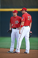 Harrisburg Senators second baseman Cutter Dykstra (7) talks with first baseman Ryan Zimmerman (31), on a rehab assignment from the Washington Nationals, during a game against the New Hampshire Fisher Cats on July 21, 2015 at Metro Bank Park in Harrisburg, Pennsylvania.  New Hampshire defeated Harrisburg 7-1.  (Mike Janes/Four Seam Images)