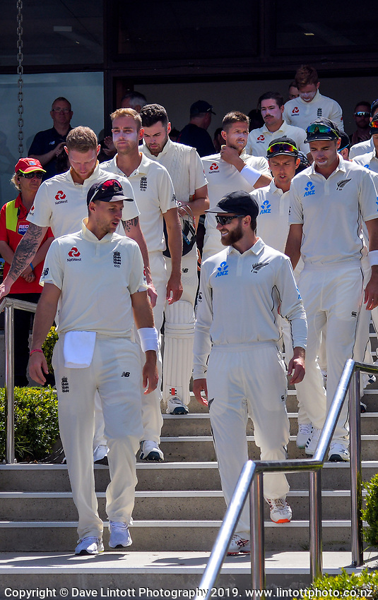 Team captains Joe Root and Kane Williamson lead their teams out for day one of the international cricket 1st test match between NZ Black Caps and England at Bay Oval in Mount Maunganui, New Zealand on Thursday, 21 November 2019. Photo: Dave Lintott / lintottphoto.co.nz