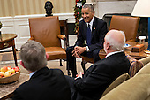 U.S. President Barack Obama, center, laughs as he meets with the 2016 American Nobel Prize laureates including J. Fraser Stoddart, professor at Northwestern University and laureate of the 2016 Nobel Prize in chemistry, right, and J. Michael Kosterlitz, professor at Brown University and laureate of the 2016 Nobel Prize in physics, left, in the Oval Office of the White House in Washington, D.C., U.S., on Wednesday, Nov. 30, 2016. Annual prizes for achievements in physics, chemistry, medicine, peace and literature were established in the will of Alfred Nobel, the Swedish inventor of dynamite, who died in 1896.<br /> Credit: Andrew Harrer / Pool via CNP