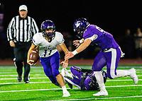 Ozark vs Elkins - Tyler Sanders (11) of Ozark running the ball as Hayden Hurst closes in for tacklet at John Bunch Field, Elkins, AR  on Friday, November 2 2018.   Special to NWA Democrat-Gazette/ David Beach