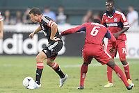 D.C. United midfielder Nick DeLeon (18) goes against Chicago Fire defender Jalil Anibaba (6) D.C. United defeated The Chicago Fire 4-2 at RFK Stadium, Wednesday August 22, 2012.