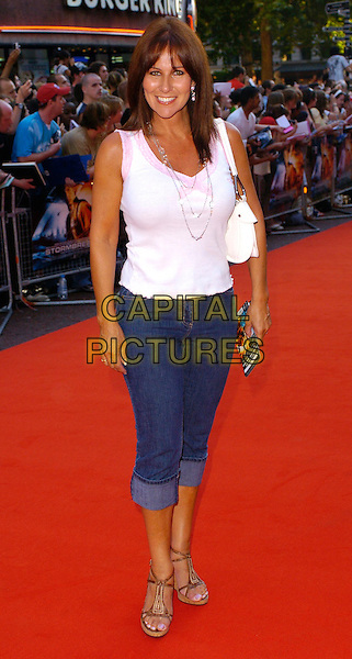 "LINDA LUSARDI .The ""Stormbreaker"" world premiere at Vue West End, London, UK..July 17th, 2006.Ref: CAN.full length jeans denim rolled up turned pink sleeveless top.www.capitalpictures.com.sales@capitalpictures.com.©Capital Pictures"