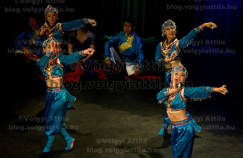 Peiyang Dance Ensemble performs mongol dances during the lunar new year gala program organized by the Confucius Institute of ELTE University in Budapest, Hungary on February 16, 2011. ATTILA VOLGYI