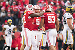 Wisconsin Badgers teammates celebrate during an NCAA College Big Ten Conference football game against the Michigan Wolverines Saturday, November 18, 2017, in Madison, Wis. The Badgers won 24-10. (Photo by David Stluka)