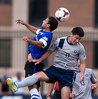 Bruno Castro (7) of Creighton goes up for a header with Tom Skelly (17) of Georgetown during the game at Shaw Field on the campus of the Georgetown University in Washington, DC.  Georgetown tied Creighton, 0-0, in double overtime.