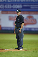 First base umpire Mickey Smith works the Appalachian League playoff game between the Burlington Royals and the Pulaski Yankees at Calfee Park on September 1, 2019 in Pulaski, Virginia. The Royals defeated the Yankees 5-4 in 17 innings. (Brian Westerholt/Four Seam Images)