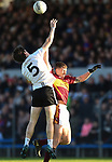 Kevin Hehir of Ennistymon in action against Kieran Malone of  St. Joseph's Miltown during the county senior football final at Cusack Park. Photograph by John Kelly.