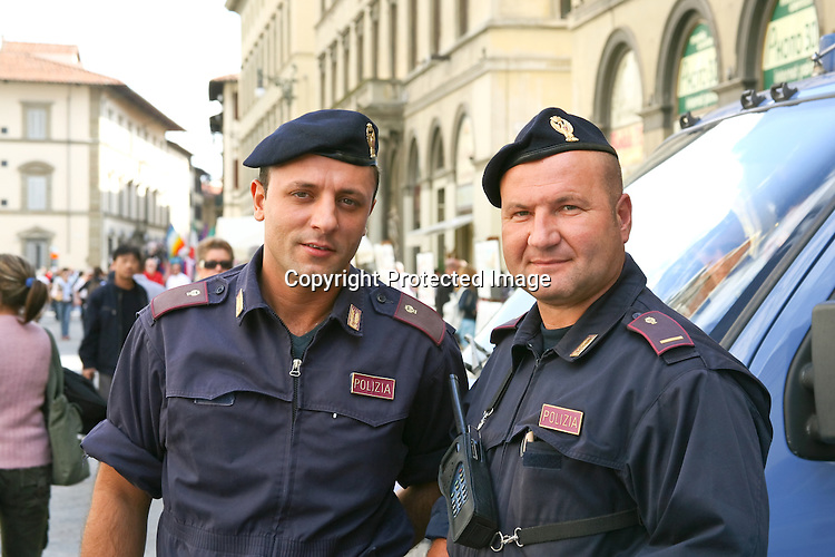 Standing aside from the crowds near the Doumo in Florence, the pair of public protectors were willing subjects.