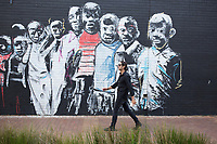 MABONENG, SOUTH AFRICA - MARCH 22: Property developer Jonathan Liebmann walks past a graffiti wall close to his office in Maboneng district on March 22, 2016 in downtown Johannesburg, South Africa. The building is the idea of Mr. Liebmann and celebrated architect David Adjaye. Maboneng is mostly owned and controlled by Mr. Liebmann. A former derelict industrial area, and a no-go area after dark, Maboneng is now a vibrant area with artists, businesses, galleries and tourists. A racially mixed cultural hub with markets on the weekend. (Photo by Per-Anders Pettersson/Getty Images)