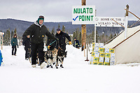 Nulato checkpoint volunteers help Jeff King's team turn around and leave the checkpoint during 2008 Iditarod