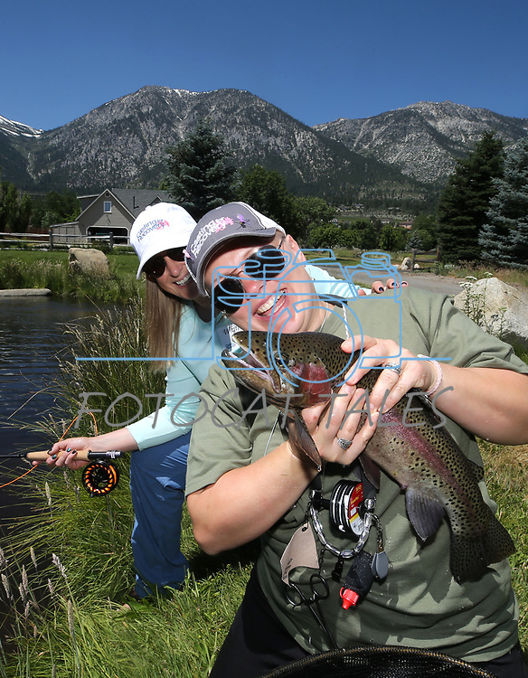Fishing guide Whitney Inmon poses with cancer survivor Chelle Futch during a Casting for Recovery retreat in Gardnerville, Nev., on Friday, June 30, 2017. <br /> Photo by Cathleen Allison/Nevada Photo Source