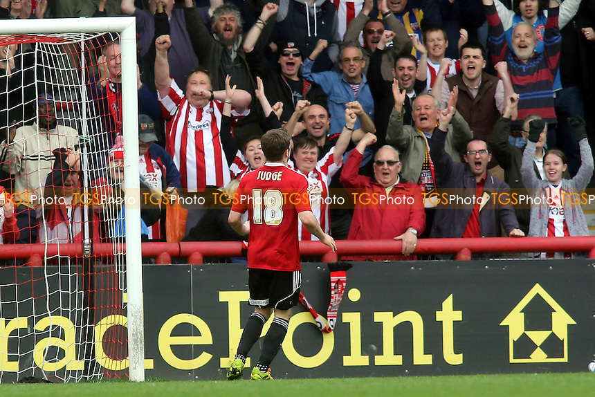 Brentford fans celebrate their second goal scored by Alan Judge - Brentford vs Notts County - Sky Bet League One Football at Griffin Park, London - 05/04/14 - MANDATORY CREDIT: Paul Dennis/TGSPHOTO - Self billing applies where appropriate - 0845 094 6026 - contact@tgsphoto.co.uk - NO UNPAID USE