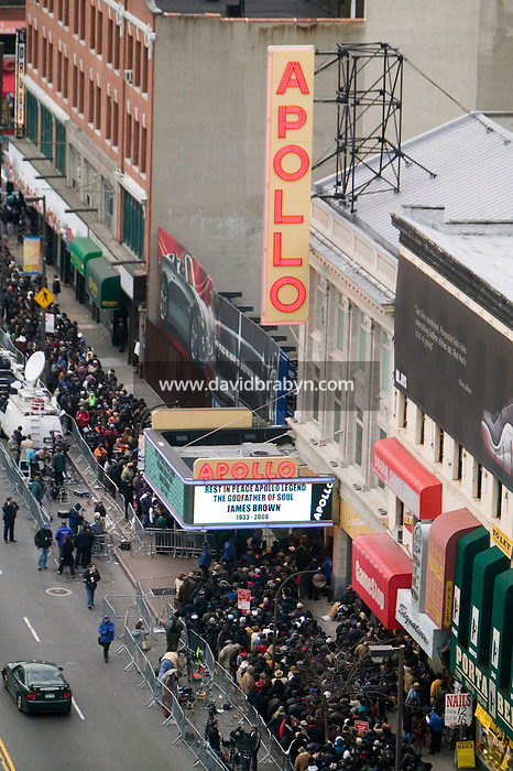 """28 December 2006 - New York City, NY - People line up outside the Apollo theater on 125th street in Harlem, New York City, USA, to see the body of singer James Brown lying in wake inside. Brown, known as the """"Godfather of Soul"""" died on Christmas Day."""