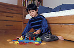 Berkeley CA Boy, four-years-old (half-Latino) sorting shapes according to color  MR