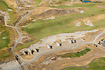 massive concrete remnants from the site's past as a sand and gravel mine lie adjacent to the 18th hole in this aerial view of Chambers Bay Golf Course, site of the 2015 US Open Championship; University Place, WA near Tacoma