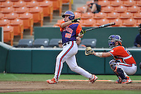 Junior catcher Chris Okey (25) of the Clemson Tigers in a fall practice intra-squad Orange-Purple scrimmage on Sunday, September 27, 2015, at Doug Kingsmore Stadium in Clemson, South Carolina. The catcher is Chris Williams. (Tom Priddy/Four Seam Images)
