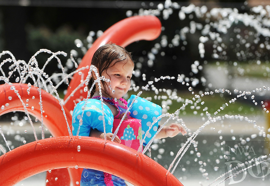 NWA Democrat-Gazette/MICHAEL WOODS &bull; @NWAMICHAELW<br /> Olivia Smith, 2 from Arlington, Texas, cools off in the water Saturday, July 23, 2016 while visiting her aunt at the Springdale Aquatic Center.  Recent temperatures have prompted a heat advisory for the Northwest Arkansas and surrounding area until Sunday afternoon with heat indices expected from 102-109 degrees.