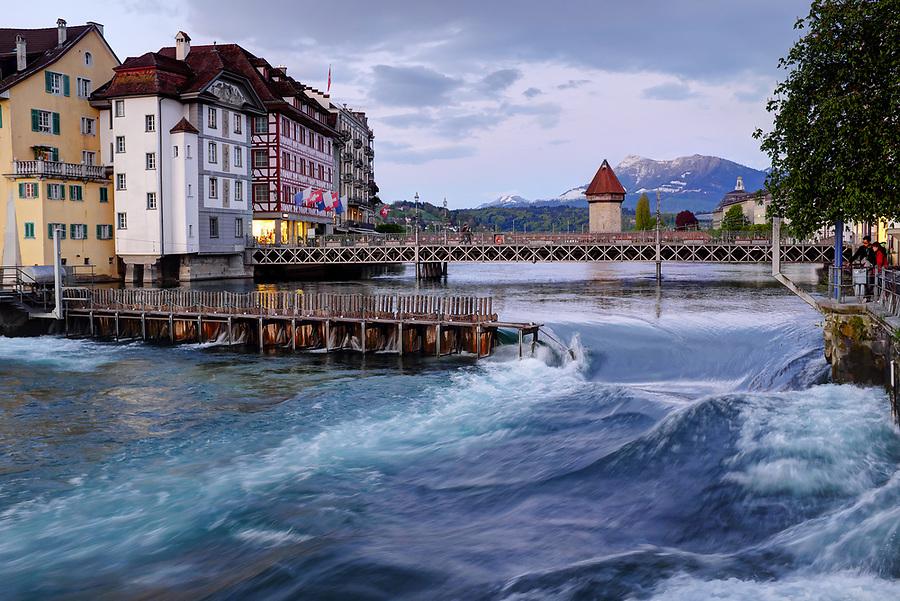 River Reuss running through Lucerne at dusk, Switzerland, Europe