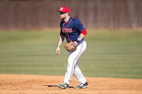 Shippensburg Raiders second baseman Jimmy Spanos (13) on defense against the Belmont Abbey Crusaders at Abbey Yard on February 8, 2015 in Belmont, North Carolina.  The Raiders defeated the Crusaders 14-0.  (Brian Westerholt/Four Seam Images)