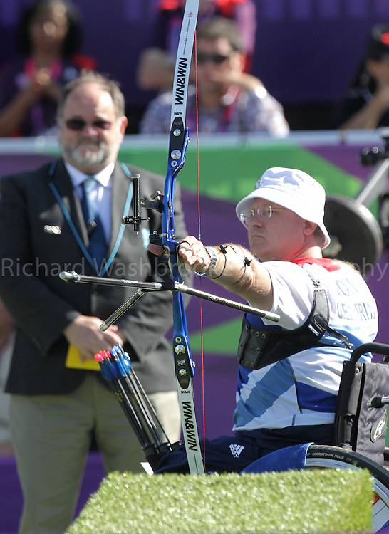 Paralympics London 2012 - ParalympicsGB - Archery..Men's Team Recurve - Open 5th September 2012 held at the Royal Artillery Barracks,  Paralympic Games in London. Photo: Richard Washbrooke/ParalympicsGB), Paul Browne competing against the Republic of Korea in the semi final